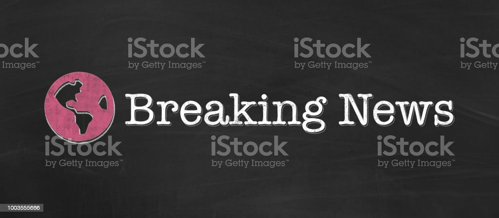 Breaking News written in chalk on black background as banner stock photo