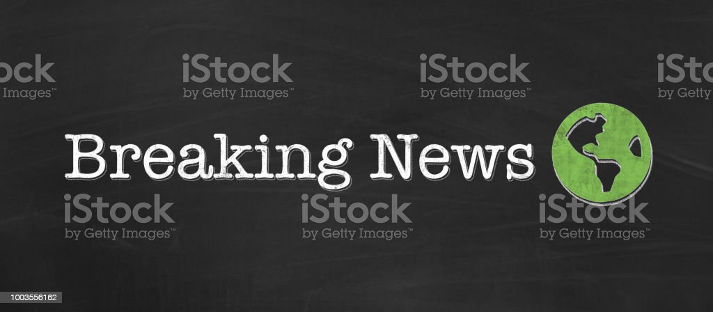 Breaking News written in chalk on black background as banner stock photo