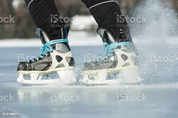 Photo of Breaking skater on frozen lake