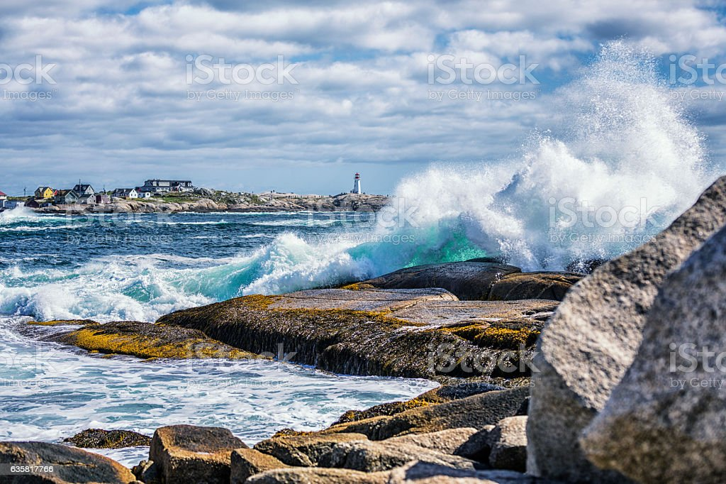 Breaking Surf Splashes Near Peggy's Point Lighthouse Peggy's Cove Canada stock photo