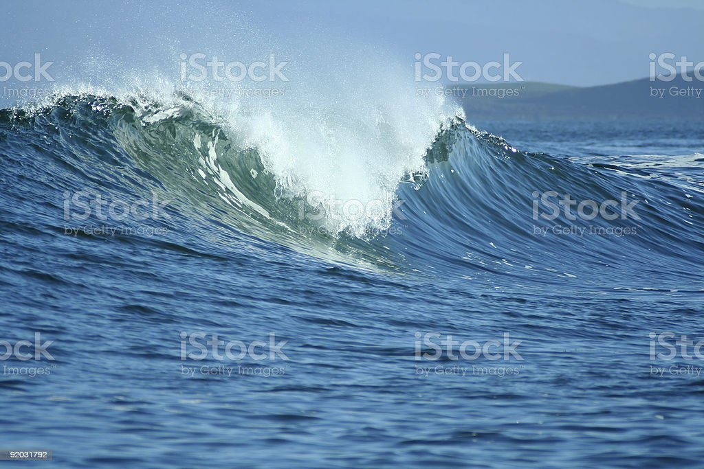 A breaking wave crashing back down into the ocean stock photo