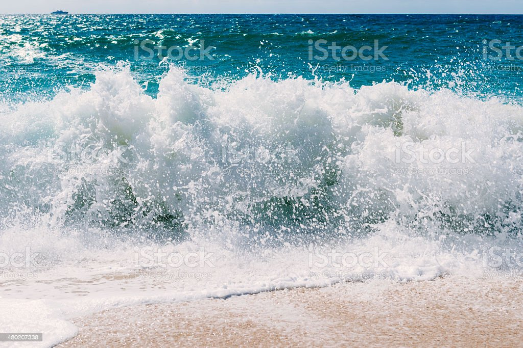 breaking wave on the shorline stock photo
