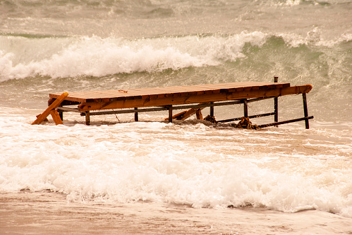 Breaking waves on a Wooden jetty