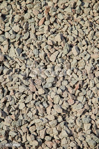 Breakstone background, a pile of crushed stone. Road gravel, gravel texture.  Piles of limestone rocks. Break stones on construction site.