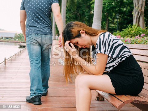 istock Breakup couple with sad girlfriend and boyfriend walking away 544331632