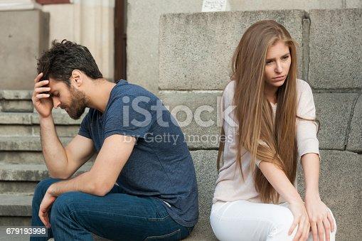 544331632istockphoto Breakup of a couple with bad girl and sad boyfriend 679193998