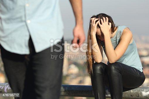 544331632istockphoto Breakup of a couple with bad guy and sad girlfriend 476733712