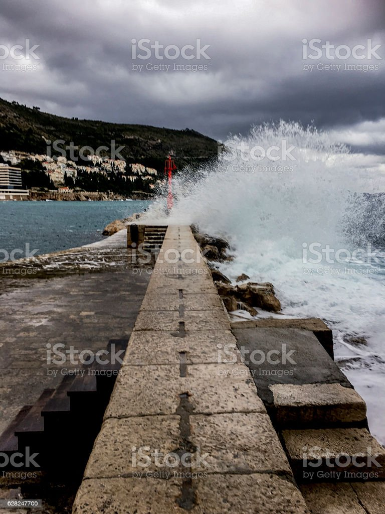 Breakwater at Dubrovnik Old Port with Big Splash ストックフォト