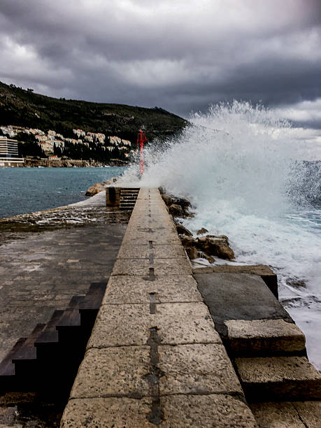 Breakwater at Dubrovnik Old Port with Big Splash ストックフォト