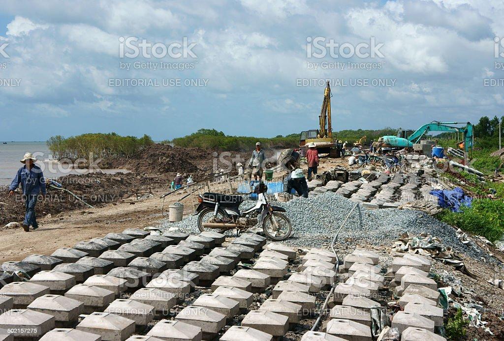 breakwater construction site stock photo