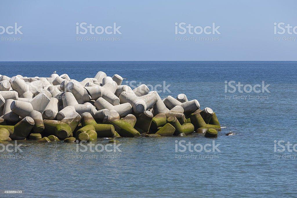 Breakwater of tetrapods at the Atlantic coast of Madeira, Portugal stock photo