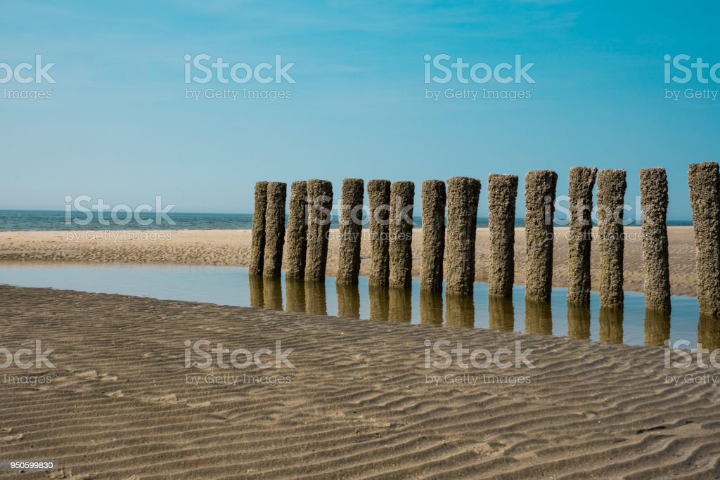 breakwaters on the beach of Burgh Haamstede, The Netherlands stock photo