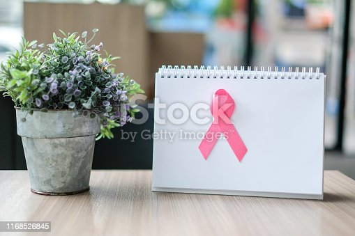 istock Breast Cancer Awareness month (October), Pink Ribbon on white paper for supporting people living and illness. Woman Healthcare and World cancer day concept with copy space for your text 1168526845