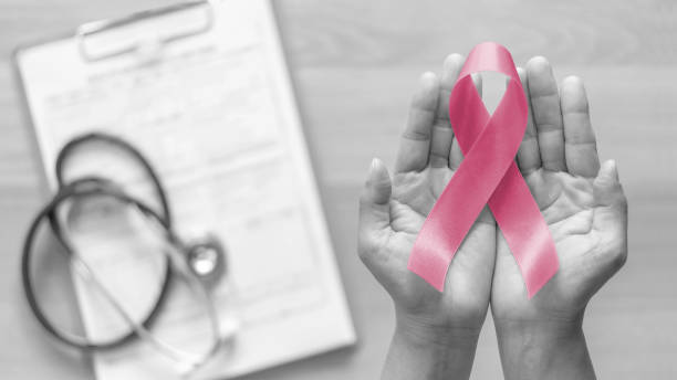 Breast cancer awareness pink ribbon for Wear pink day charity in october month for woman health and patient survivor fighting with breast tumor illness (bow isolated with clipping path) stock photo