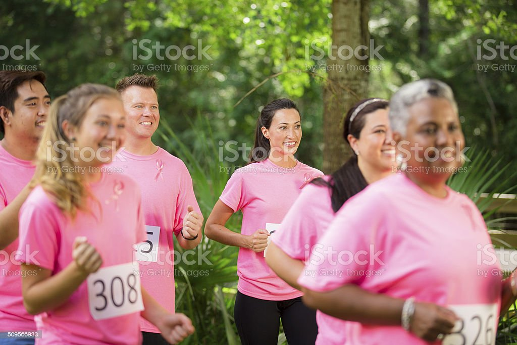 Breast Cancer Awareness volunteers run charity race. stock photo