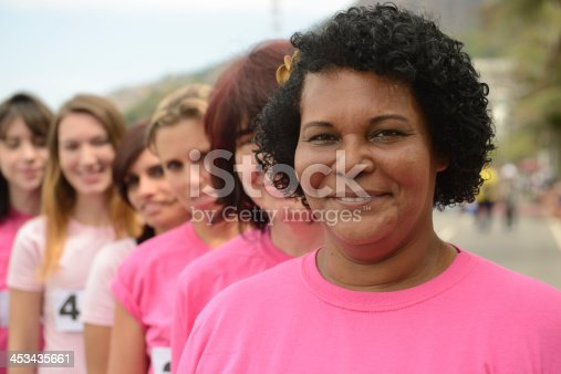 istock Breast cancer charity race, woman in pink. 453435661