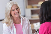Breast cancer patient talks with counselor