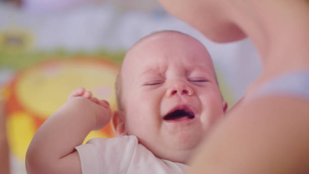Breast-Feeding. Close up on crying baby stock photo