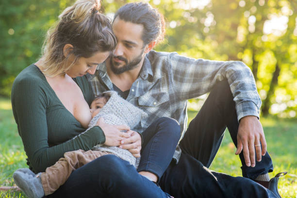 Breastfeeding in the Park stock photo