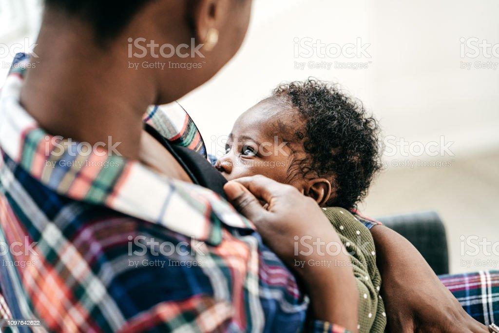 Breastfeeding moment stock photo