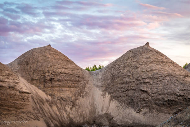 Breasts made out of 2 sand piles stock photo