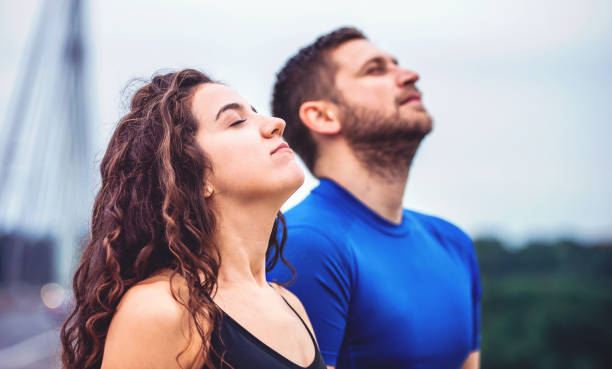 Breath a fresh air. Young couple enjoys together in the morning training outdoor. Sport, fitness, recreation concept stock photo