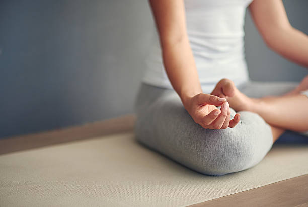 Breathe and release anything that does not serve you Cropped shot of a young woman practicing yogahttp://195.154.178.81/DATA/i_collage/pi/shoots/806303.jpg lotus position stock pictures, royalty-free photos & images