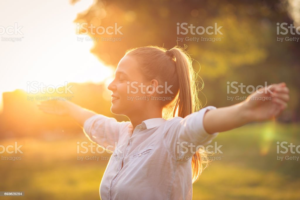 Breathing exercise in nature in sunset stock photo
