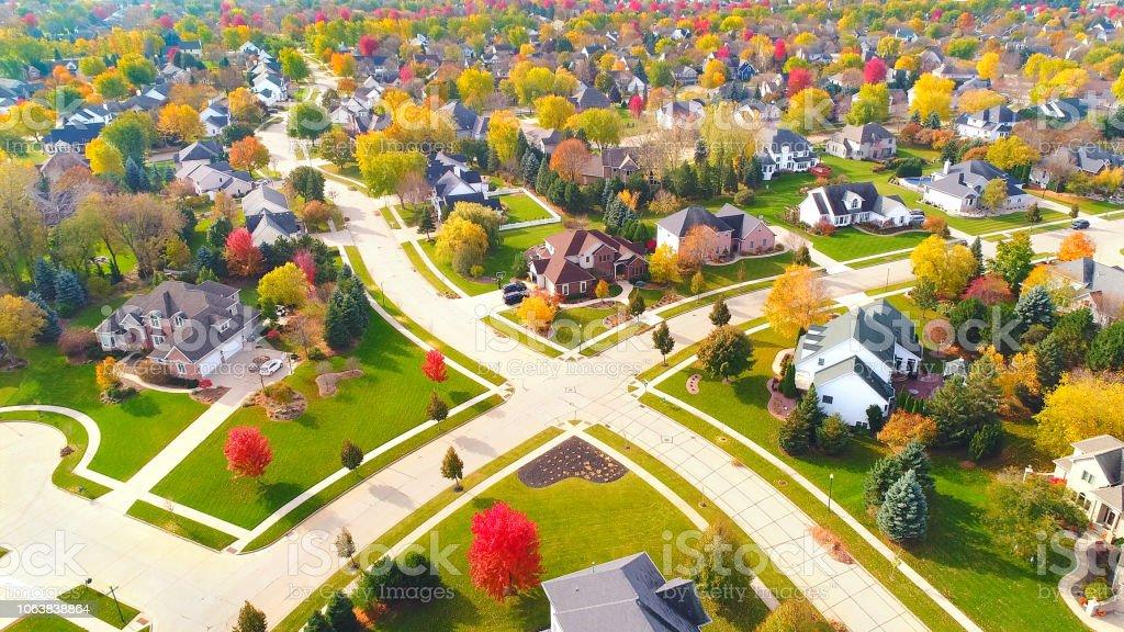 Breathtaking aerial view of idyllic Autumn neighborhoods. stock photo