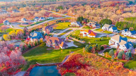 Breathtaking Autumn colors in neighborhood foliage, aerial flyover.