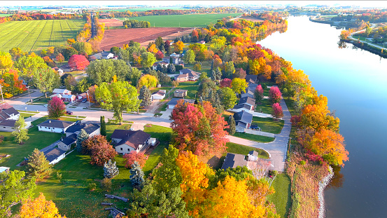 Breathtaking Autumn colors, waterfront foliage, aerial flyover.