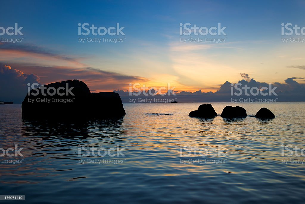 Breathtaking colorful tropical sunset with rocks infront (XXXL) royalty-free stock photo