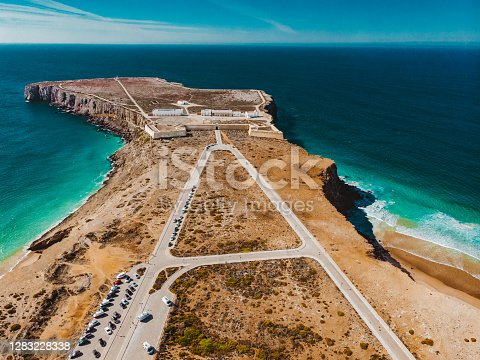 Sagres Fortress – Fortaleza de Sagres and the Church of Our Lady of Grace – Igreja de Nossa Senhora da Graça, Portugal as seen from the drone view. Henry the Navigator ordered the construction of this fortress to protect the strategic coastal position at Ponta de Sagres, and the coves that sheltered shipping.