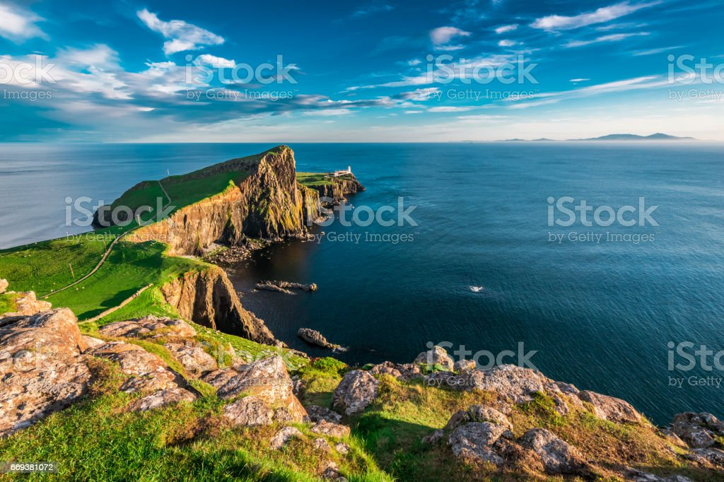 Breathtaking dusk at the Neist point lighthouse in Scotland stock photo