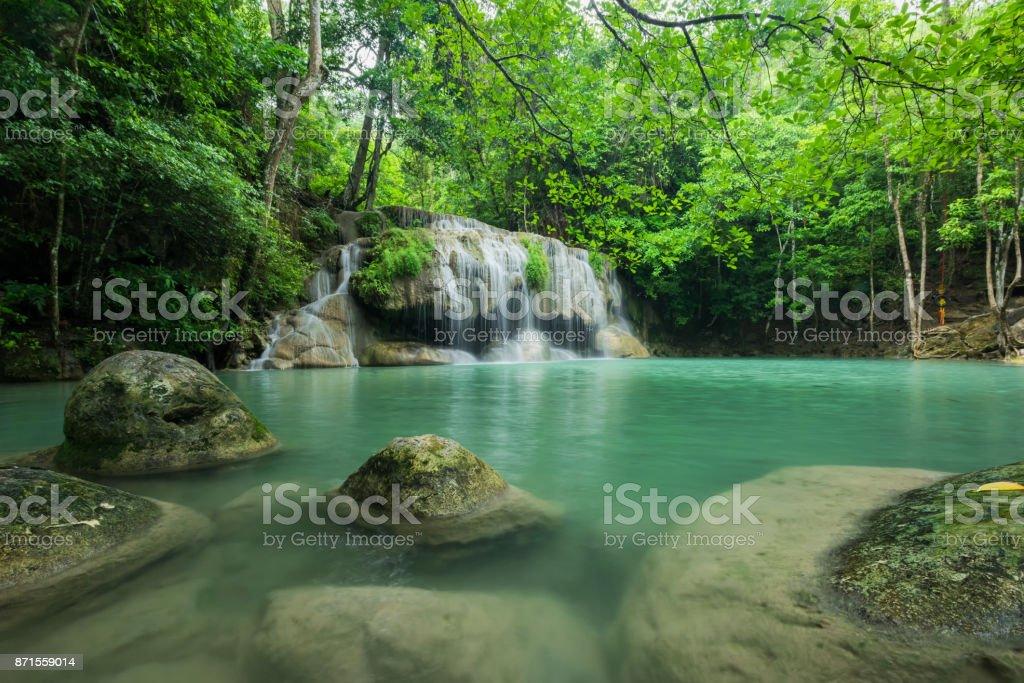 Breathtaking green waterfall at deep forest, Erawan waterfall located Kanchanaburi Province, Thailand stock photo