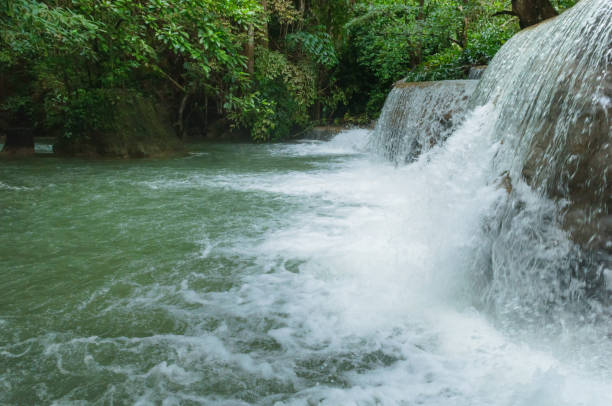 breathtaking green waterfall at deep forest, erawan waterfall located kanchanaburi province, thailand - dazzlingly stock pictures, royalty-free photos & images