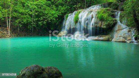 Breathtaking green waterfall at tropical rain forest, Erawan waterfall located Kanchanaburi Province, Thailand