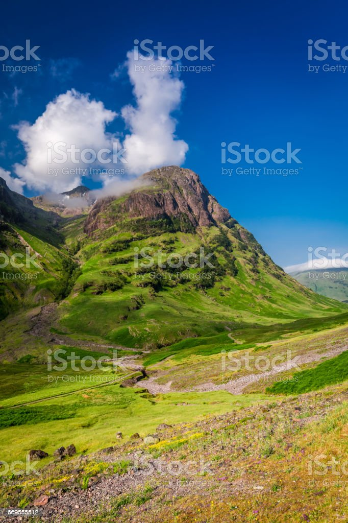 Breathtaking mountains in Glencoe at sunrise in summer, Scotland stock photo