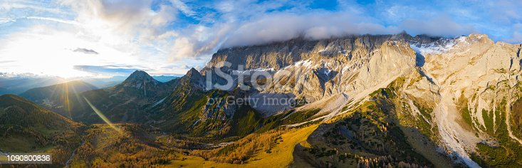 amazing aerial view beautiful panoramic view in mountain landscape sunrays over alpine pasture valley timber line rocky mountains summit covered with clouds