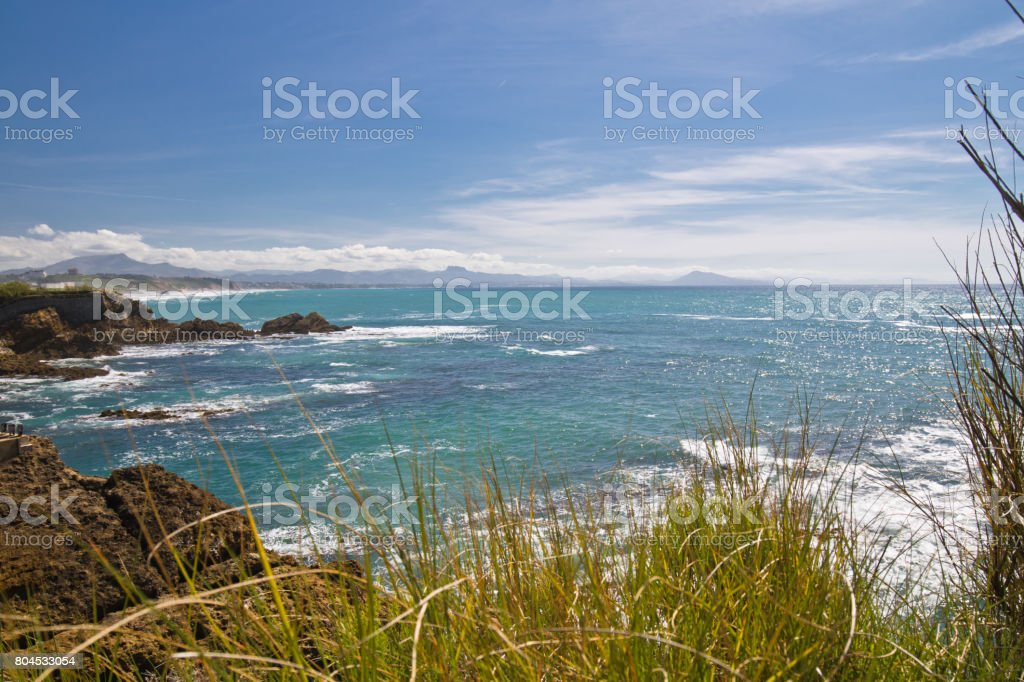 breathtaking panoramic view on beautiful atlantic coastline with turquoise ocean vegetation and mountains in basque country surf destination, biarritz, france stock photo