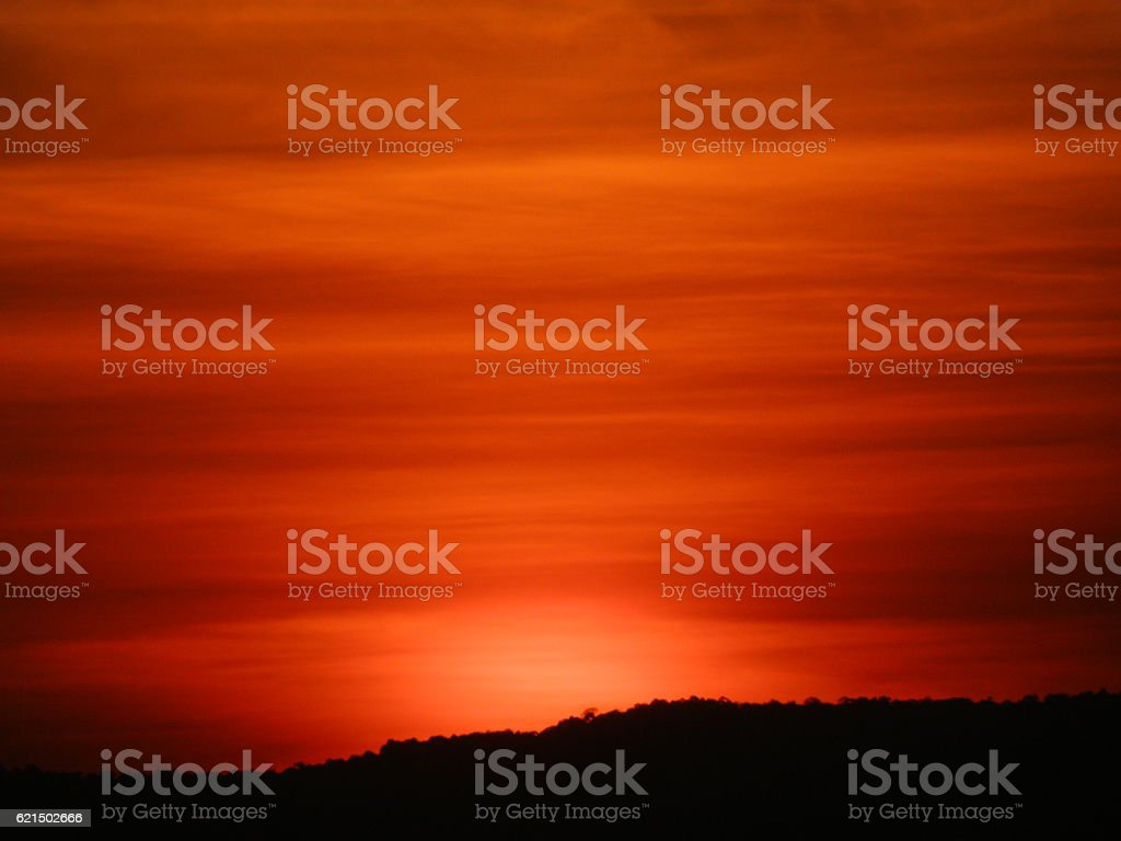 Breathtaking red color gradation of sunset sky over the hills foto stock royalty-free