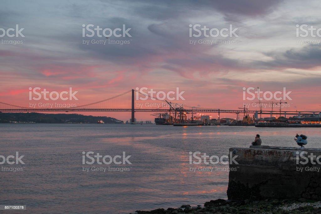 Breathtaking sundown in Lisbon facing 25 de Abril bridge, Portugal stock photo