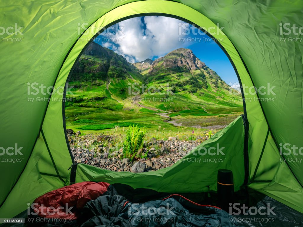 Breathtaking view from tent to Glencoe at sunrise, Scotland stock photo