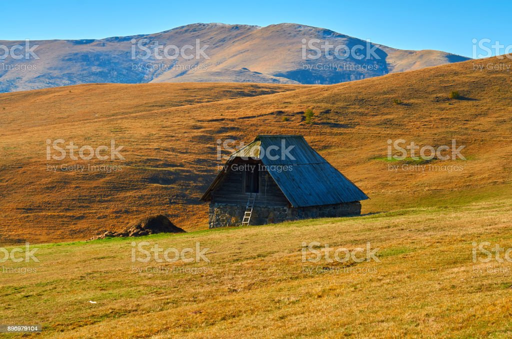 Breathtaking view of idyllic rural environment. Sheep house in middle of mountain pastures. stock photo