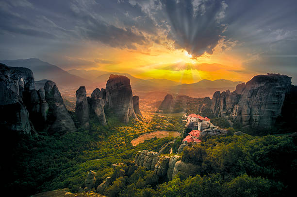Breathtaking view of Meteora, Greece Breathtaking view of Meteora Roussanou Monastery at sunset, Greece abbey monastery stock pictures, royalty-free photos & images