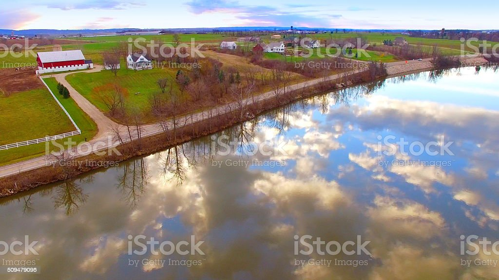 Breathtakingly Beautiful Rural Landscape With Sky Reflected in River stock photo