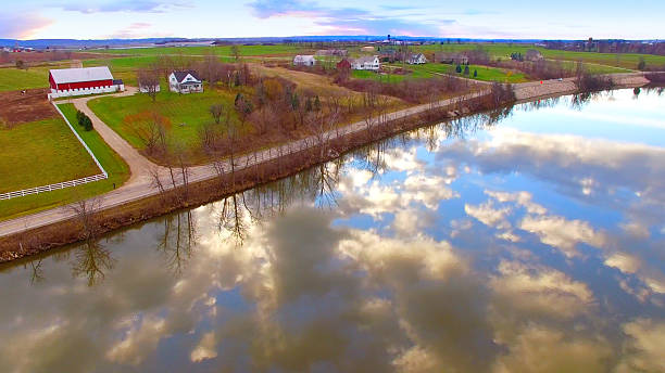 breathtakingly beautiful rural landscape with sky reflected in river - green bay wisconsin stock photos and pictures