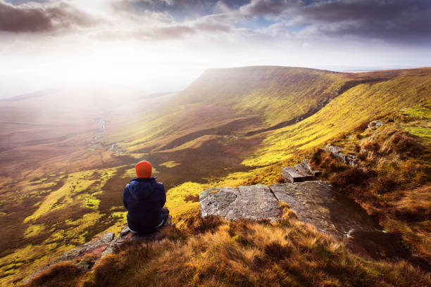 Brecon beacons landscape Lone figure against backdrop of the Brecon Beacons national park, Wales brecon beacons stock pictures, royalty-free photos & images