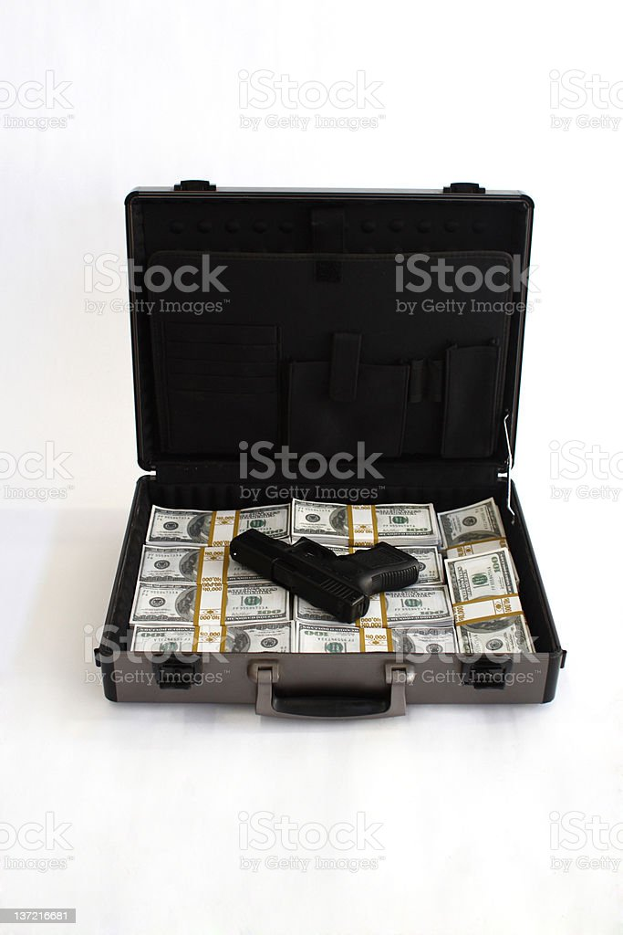 Breifcase full of cash and a pistol royalty-free stock photo