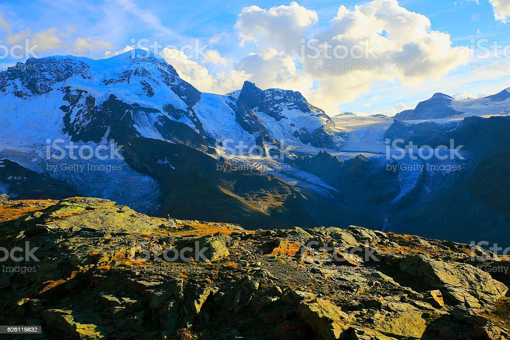Breithorn massif and Theodul glacier, dramatic golden sunset, Swiss Alps stock photo